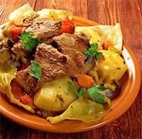 Мясо, тушенное с овощами